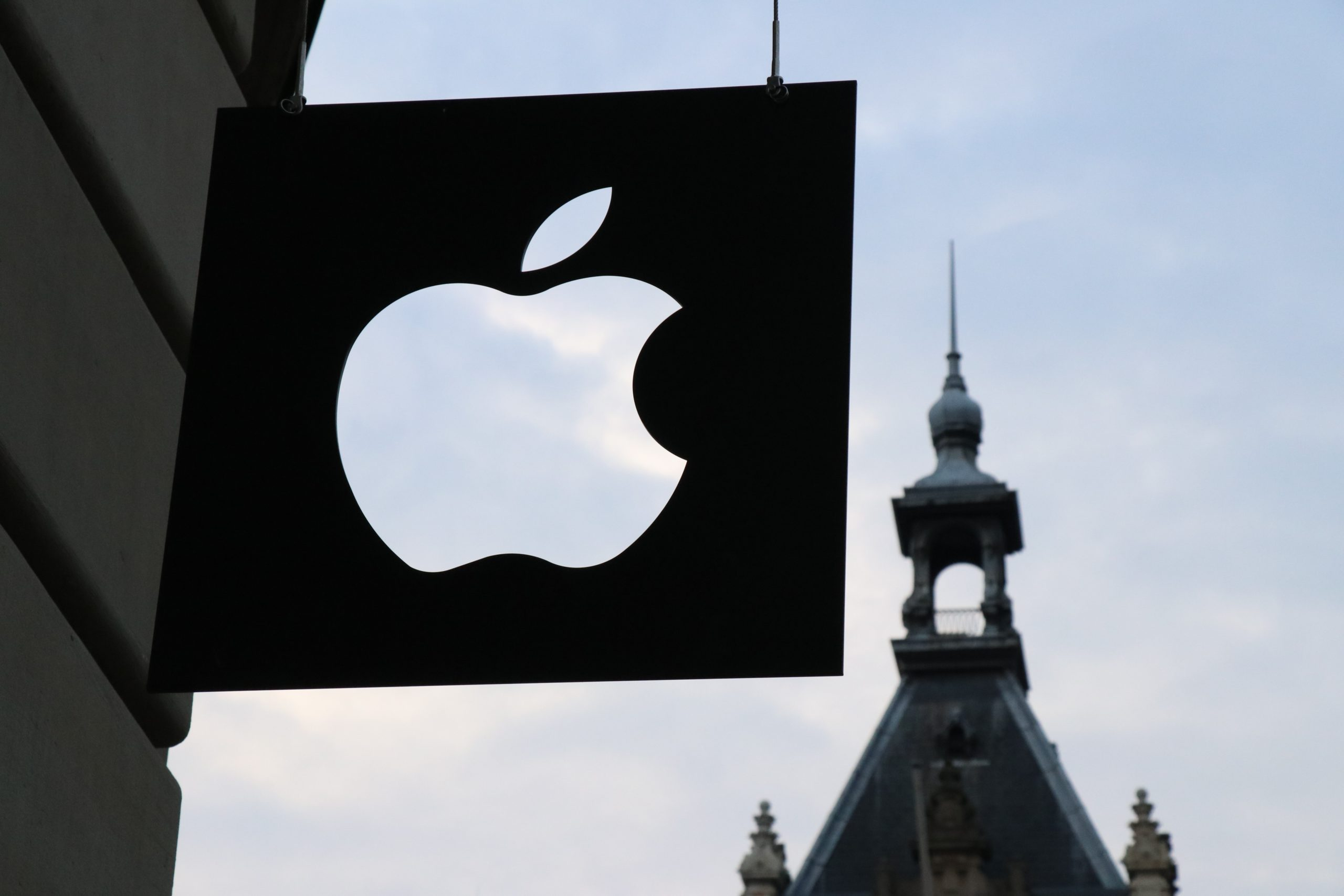 Apple logo in front of a building
